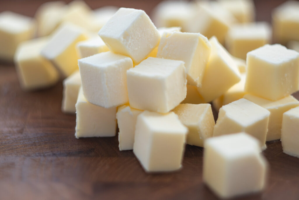 cutting board with cubed butter