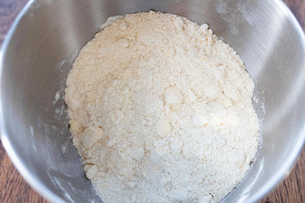 Cut the butter into the flour