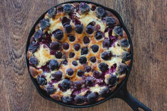 cherry clafoutis in a cast iron skillet
