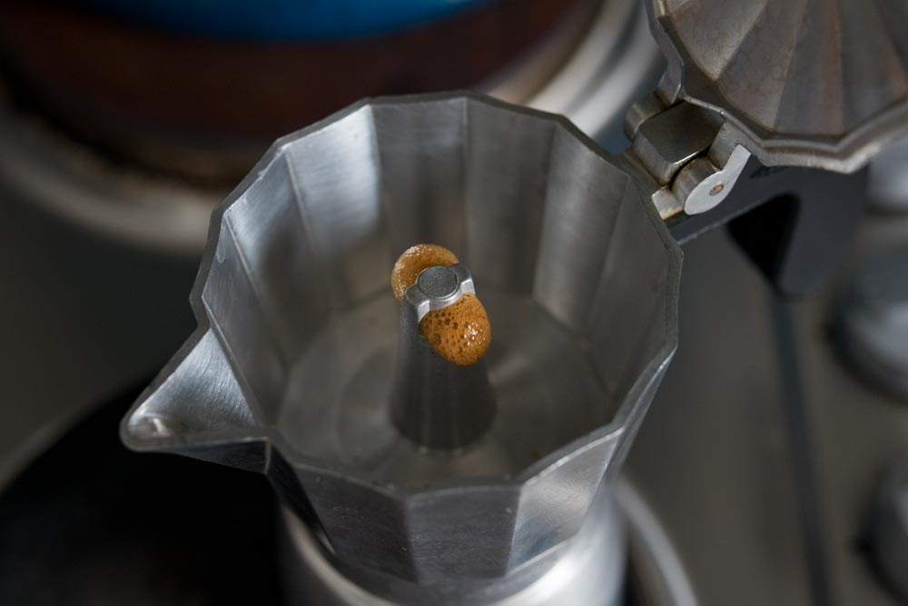 brewing coffee in a moka pot