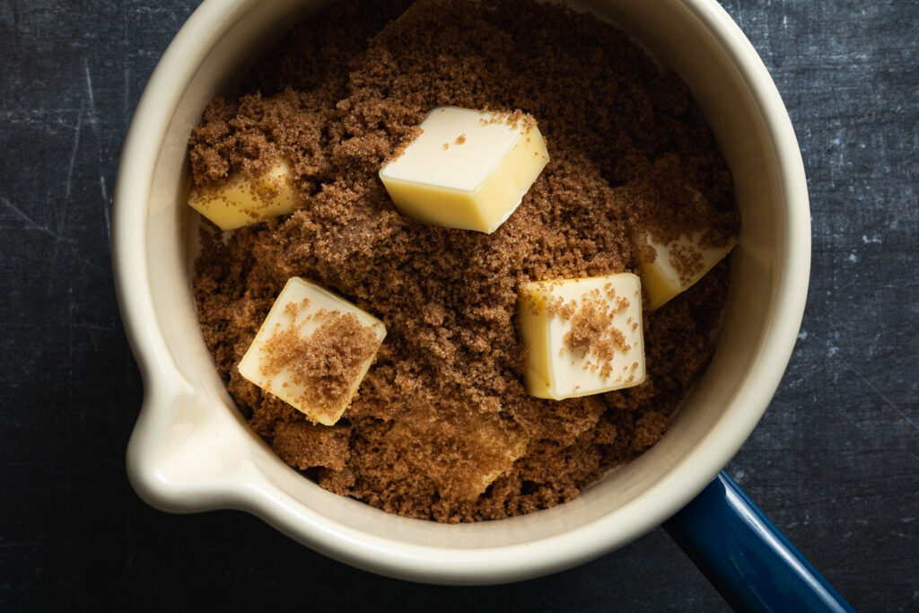 butter and dark brown sugar in a small enameled saucepan