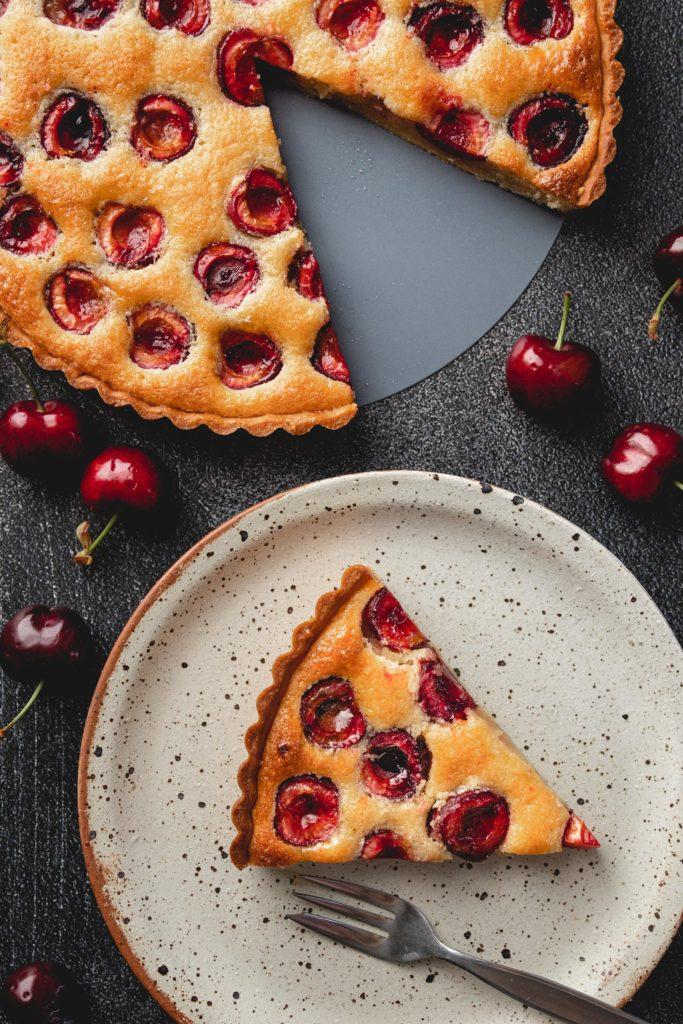 slice of cherry frangipane tart