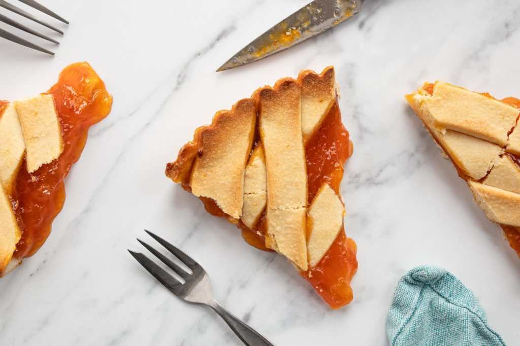 slices of apricot jam crostata