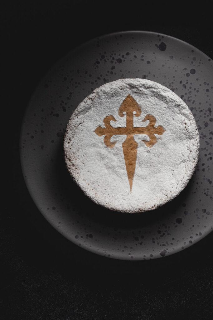 dark and moody food photography of tarta de santiago cake