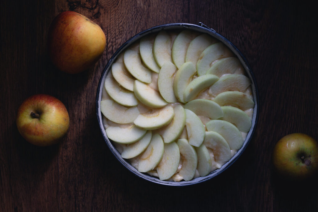 arrange the apple slices on top of the batter