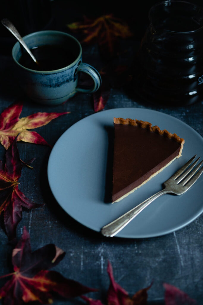 a slice of tarte au chocolate and a cup of coffee