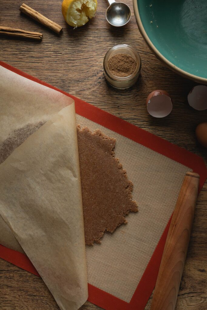 rolling out the zimtsterne cinnamon star cookie dough