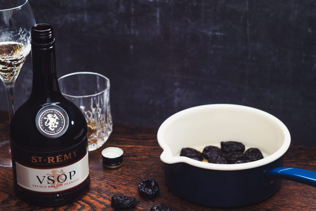 bottle of brandy and a pan of prunes
