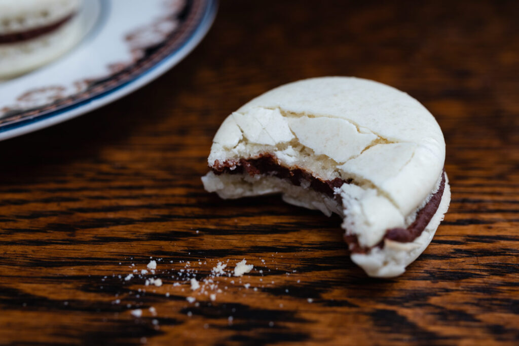 almond macaron with chocolate ganache with bite missing