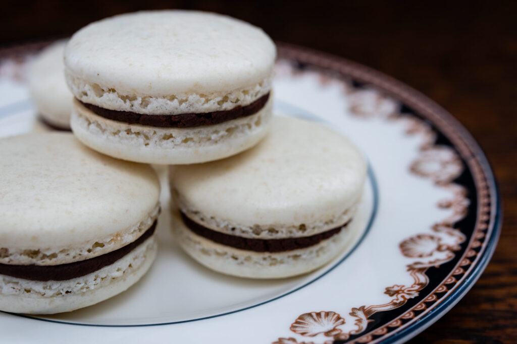 macarons stacked on a porcelain plate