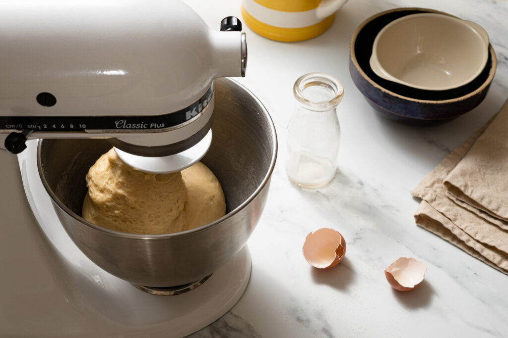 kneading zeeuwse bolus dough in a white Kitchen-aid mixer