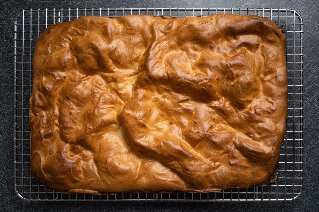 a layer of baked choux pastry on a cooling rack